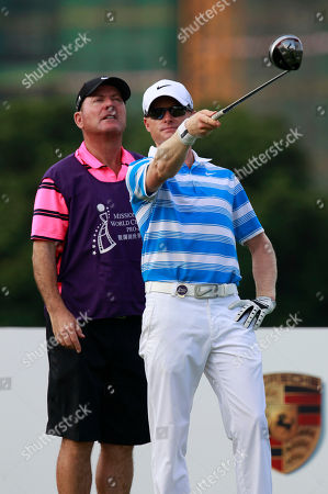 Simon Dyson English professional golfer Simon Dyson, right, and his caddie chat each other before teeing off during the first round of the World Celebrity Pro-Am golf tournament in Haikou, in southern China's island province Hainan on