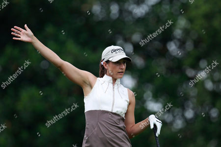 Stock Photo of Paige Mackenzie American golfer Paige Mackenzie gestures after hitting a shot on a fairway during the first round of the World Celebrity Pro-Am golf tournament in Haikou, in southern China's island province Hainan on