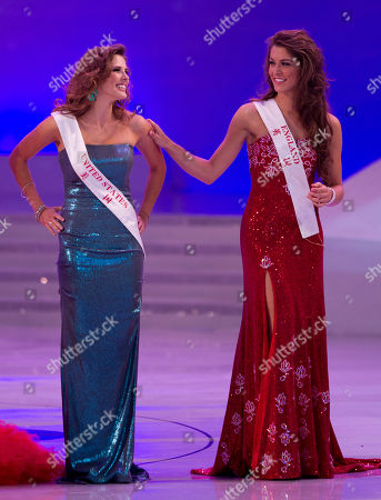 Charlotte Holmes, Claudine Book Miss England Charlotte Holmes, right, shares a light moment with Claudine Book of the United States on stage during the Miss World 2012 beauty pageant at the Ordos Stadium Arena in inner Mongolia, China