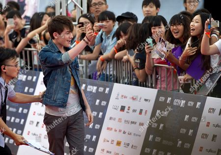 Greyson Chance U.S. singer Greyson Chance, left, waves to Chinese fans upon arrival at the MTV Award Gala in Beijing