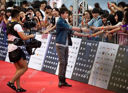 Greyson Chance U.S. singer Greyson Chance, center, is greeted by Chinese fans upon arrival at the MTV Award Gala in Beijing