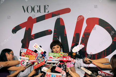 Sun Li Chinese actress Sun Li, center, is surrounded by journalists on the red carpet of Vogue Fashion's Night Out event in Shanghai, China