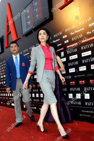Faye Wong, Li Yapeng Chinese pop icon Faye Wong, center, arrives with her husband Li Yapeng at a charity event held in Beijing