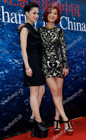 """Gillian Chung, Charlene Choi Members of the music group """"Twins,"""" Hong Kong actress-singer Gillian Chung, left, and Charlene Choi arrive for a charity event in Beijing"""