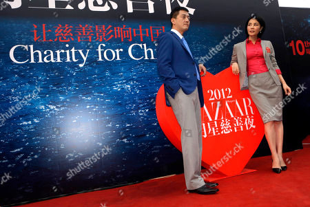 Faye Wong, Li Yapeng Chinese pop icon Faye Wong, right, poses with her husband Li Yapeng at a charity event held in Beijing
