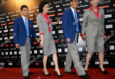 Faye Wong, Li Yapeng Chinese pop icon Faye Wong, second from left, walks in front of her husband Li Yapeng as they arrive at a charity event held in Beijing