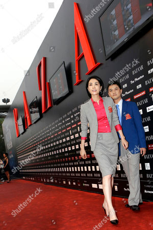 Stock Image of Faye Wong, Li Yapeng Chinese pop icon Faye Wong, center, arrives with her husband Li Yapeng at a charity event held in Beijing