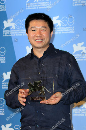 Director Wang Bing with his Orizzonti Best Film award for 'San Zimei' at the awards photo call during the 69th edition of the Venice Film Festival in Venice, Italy