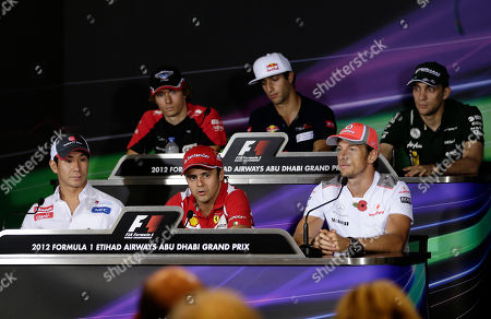 Formula One drivers from bottom from left to right, Sauber driver Kamui Kobayashi of Japan, Ferrari driver Felipe Massa of Brazil and McLaren's Jenson Button, top from left to right, Marussia Formula One driver Charles Pic of France, Toro Rosso driver Daniel Ricciardo of Australia and Caterham driver Vitaly Petrov, seen during a press conference, at the Yas Marina racetrack, in Abu Dhabi, United Arab Emirates, . The Emirates Formula One Grand Prix will take place on Sunday