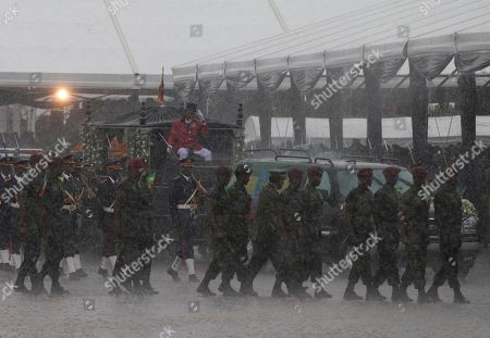 Soldiers lead the body of late Prime Minister Meles Zenawi out of Meskel Square in a downpour, at the end of a public funeral ceremony for Zenawi in Addis Ababa, Ethiopia . Thousands of mourners gathered in a public square in Ethiopia's capital on Sunday to pay their final respects to Zenawi, who was praised for lifting many out of poverty but vilified by some for restricting freedoms. Zenawi, who ruled for 21 years, died Aug. 20 of an undisclosed illness in a Belgian hospital. He was 57