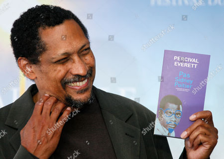 """Percival Everett U.S. writer Percival Everett poses with his book """" Pas Sidney Poitier """" during a photo-call after he was awarded with the Literary Award at the 38th American Film Festival, in Deauville, Normandy, France"""