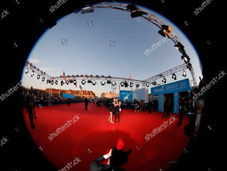 """Rebecca Thomas, Cassidy Gard A fisheye lens, U.S director Rebecca Thomas, right, and U.S actress Cassidy Gard arrive for the screening of his movie """"Taken 2"""" at the 38th American Film Festival, in Deauville, Normandy, France"""