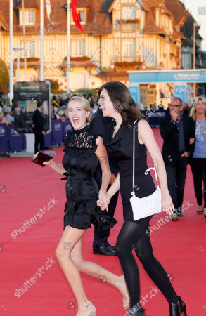 """Rebecca Thomas, Cassidy Gard U.S director Rebecca Thomas, right, and U.S actress Cassidy Gard arrive for the screening of his movie """"Taken 2"""" at the 38th American Film Festival, in Deauville, Normandy, France"""