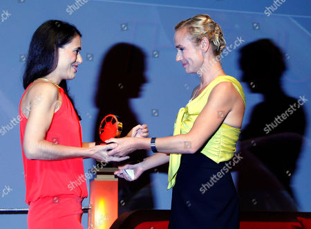 "Lucy Mulloy U.S Director Lucy Mulloy, left, holds her trophy with French actress Sandrine Bonnaire after winning the Jury Prize with her film ""Una Noche"" at the 38th American Film Festival, in Deauville, France"