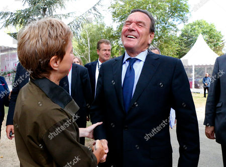 Laurence Parisot, Gerhard Schroeder Head of the French employers federation MEDEF Laurence Parisot, left, shake hands with former German Chancellor Gerhard Schroeder upon his arrival of the MEDEF summer Forum, on the campus of the HEC School of Management in Jouy-en-Josas, near Paris