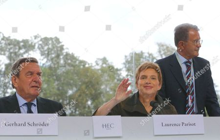 Laurence Parisot, Gerhard Schroeder Head of the French employers federation MEDEF, Laurence Parisot, center, gestures alongside former German Chancellor Gerhard Schroeder, left, and former Italian premier Romano Prodi during the MEDEF summer Forum, on the campus of the HEC School of Management in Jouy en Josas, near Paris
