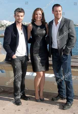 Left to right, Canadian actors Daniel Gillies, Erica Durance and Canadian actor Michael Shanks pose during the 28th MIPCOM (International Film and Programme Market for Tv, Video,Cable and Satellite) in Cannes, southeastern France