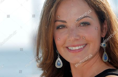 Canadian actress Erica Durance poses during the 28th MIPCOM (International Film and Programme Market for Tv, Video,Cable and Satellite) in Cannes, southeastern France