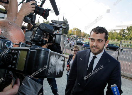 Aurelien Hamelle Aurelien Hamelle, French lawyer for the British royal couple, arrives in court in Nanterre, on the outskirts of Paris, Monday, Sept, 17, 2012 to seek an injunction against the Mondadori publishing house, owned by former Premier Silvio Berlusconi, which published a 26-page spread of topless photos of Prince William's wife Kate on Monday, to prevent further dissemination of the images. St. James's Palace said Sunday that family lawyers would file a criminal complaint against the unidentified photographer or photographers involved. The palace said it would be up to French prosecutors to decide whether to investigate and pursue a criminal case for breach of privacy or trespassing