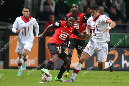 Rennes' midfielder Jean II Makoun challenges for the ball with Lille's forward Tulio De Melo during their french League One soccer match in Rennes, western France