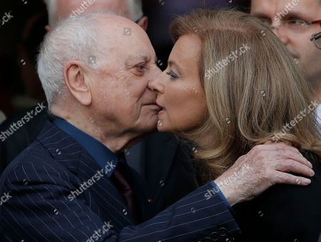 Valerie Trierweiler, Pierre Berge Valerie Trierweiler, companion of France's President Francois Hollande, right, kisses co-founder of Yves Saint Laurent Couture House and former partner of fashion designer Yves Saint Laurent, Pierre Berge, after a charity auction by the Foundation France Libertes in honour of France's former First lady Danielle Mitterrand in Paris, Thursday, Sept, 20, 2012