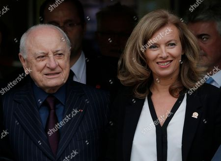Stock Photo of Valerie Trierweiler, Pierre Berge Valerie Trierweiler, companion of France's President Francois Hollande, right, stands with co-founder of Yves Saint Laurent Couture House and former partner of fashion designer Yves Saint Laurent, Pierre Berge, after a charity auction by the Foundation France Libertes in honour of France's former First lady Danielle Mitterrand in Paris, Thursday, Sept, 20, 2012