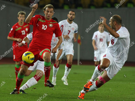 Stock Photo of Zurab Khizanishvili, Renan Bressan Georgia's Zurab Khizanishvili, right, challenges Belarus's Renan Bressan, left, for the ball during their 2014 World Cup qualifying match in Tbilisi, Georgia