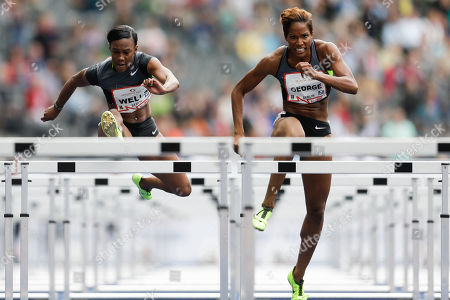 Kellie Wells, Phylicia George Kellie Wells from the US, left, runs to win the women's 100 meters hurdles race at the ISTAF athletics meeting in Berlin, Germany, . At right is Phylicia George from Canada