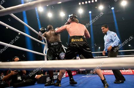 Alexander Povetkin, Hasim Rahman WBA heavyweight world boxing champion Alexander Povetkin of Russia, right, and Hasim Rahman of the U.S., left, fight for Povetkin's WBA heavyweight title in Hamburg, Germany, . Povetkin won the fight with a second-round technical knockout
