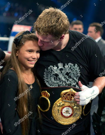 Alexander Povetkin, Arina Povetkin WBA heavyweight world boxing champion Alexander Povetkin of Russia, right, kisses his daughter Arina after he won his fight against Hasim Rahman of the U.S., in Hamburg, Germany, . Povetkin retained his WBA heavyweight title with a second-round technical knockout