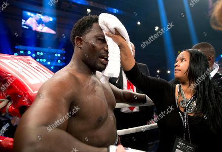Crystal Rahman, Hasim Rahman Crystal Rahman, right, the wife of Hasim Rahman of the U.S., left, wipes her husband's face after he lost his fight against WBA heavyweight world boxing champion Alexander Povetkin of Russia, in Hamburg, Germany
