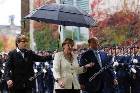 Angela Merkel, Abd Rabbuh Mansur Al-Hadi German Chancellor Angela Merkel, center, welcomes the President of the Yemen Abd Rabbuh Mansur Al-Hadi, right, for talks at the chancellery in Berlin, Germany