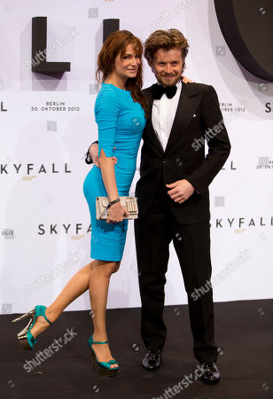 "Alexandra Kamp, Michael von Hassel German actress Alexandra Kamp, left, and Michael von Hassel, right, pose for photographers before the German premiere of the the twenty-third James Bond film ""Skyfall"" in Berlin, Germany"