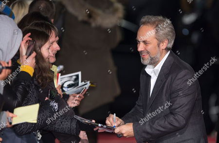 "Sam Mendes FILE - A photo from files showing British director Sam Mendes signing autographs as he arrives for the German premiere of the James Bond film ""Skyfall"" in Berlin. The return of director Sam Mendes and a long-awaited musical by Tori Amos are among productions slated for the 50th anniversary season at Britain's National Theatre, Wednesday, Jan. 30, 2013. ""Skyfall"" filmmaker Mendes will direct a production of Shakespeare's ""King Lear,"" starring Simon Russell Beale, opening next January. The 2013 season will see ""The Light Princess,"" a musical adaptation of a 19th-century fairytale by Amos and playwright Samuel Adamson. First announced two years ago, it will finally open in October"