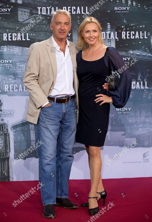 "Christoph M. Ohrt, Dana Golombeck Christoph M. Ohrt, left, and Dana Golombeck arrive for the German premiere of the movie ""Total Recall"" in Berlin, Germany"
