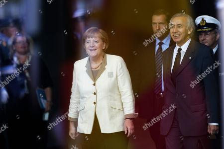 Angela Merkel German Chancellor Angela Merkel, left, waits for the arrival of the President of the Yemen Abd Rabbuh Mansur Al-Hadi, unseen, for talks at the chancellery in Berlin