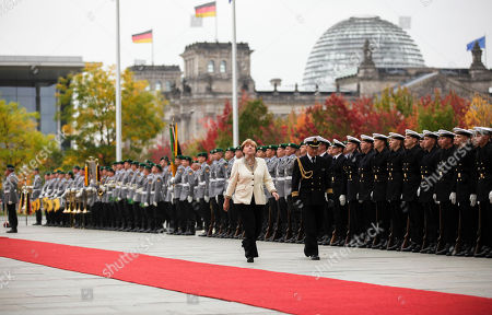 Angela Merkel German Chancellor Angela Merkel walks in front of the honor guards prior to the arrival of the President of the Yemen Abd Rabbuh Mansur Al-Hadi, unseen, at the chancellery in Berlin
