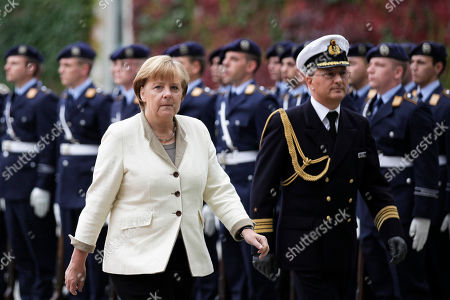 Angela Merkel German Chancellor Angela Merkel, front left, walks in front of the honor guards prior to the arrival of the President of the Yemen Abd Rabbuh Mansur Al-Hadi, not pictured, at the chancellery in Berlin