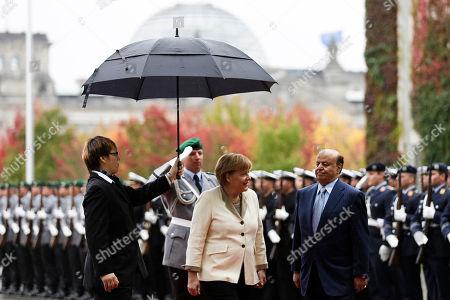 Stock Image of Angela Merkel, Abd Rabbuh Mansur Al-Hadi German Chancellor Angela Merkel, second from right, welcomes the President of the Yemen Abd Rabbuh Mansur Al-Hadi, right, for talks at the chancellery in Berlin, Germany