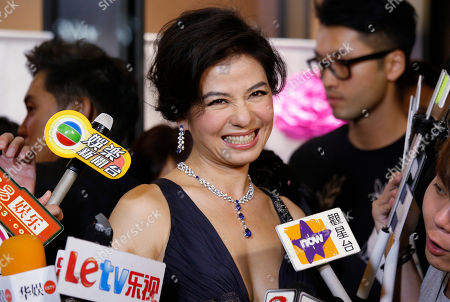 Cherie Chung Cherie Chung, former Miss Hong Kong, smiles at the opening of the Piaget flagship store in Hong Kong