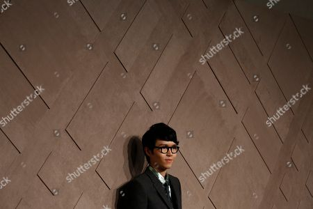Khalil Fong Hong Kong singer Khalil Fong poses during the opening ceremony of the new Burberry flagship store in Hong Kong