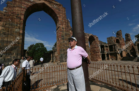 Liang Guanglie Chinese Defense Minister Liang Guanglie puts his arms around the Iron Pillar of Delhi during his visit to the landmark monument Qutub Minar in New Delhi, India, . Liang and his Indian counterpart A.K. Antony agreed Tuesday to resume joint military exercises frozen two years ago, signaling a thaw between the Asian giants even as regional relations are tense over the disputed South China Sea