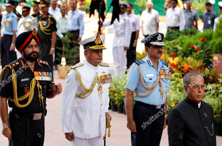 Stock Photo of Pranab Mukherjee, N.A.K. Browne, Nirmal Verma, Bikram Singh From right, Indian President Pranab Mukherjee, Air Force Chief N.A.K. Browne, Navy Chief Admiral Nirmal Verma and Army Chief General Bikram Singh, pay homage at the India Gate war memorial on the occasion of 65th anniversary of India's independence from British rule, in New Delhi, India