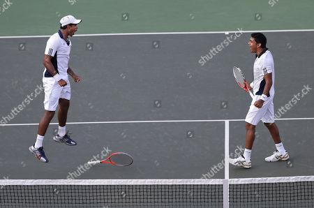 Vishnu Vardhan, Divij Sharan India's Vishnu Vardhan, left, and Divij Sharan react after winning against New Zealand's Daniel King-Turnerand Michael Venus, unseen, during their Davis Cup doubles tennis match in Chandigarh, India, . India has taken an unassailable 3-0 lead
