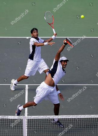 Vishnu Vardhan, Divij Sharan India's Vishnu Vardhan, right, and Divij Sharan play against New Zealand's Daniel King-Turner and Michael Venus, unseen, during their Davis Cup doubles tennis match in Chandigarh, India