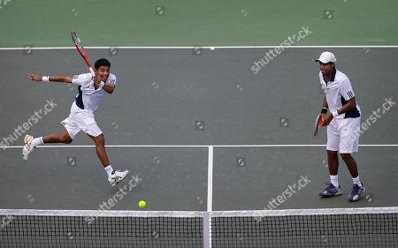 Vishnu Vardhan, Divij Sharan India's Vishnu Vardhan, left, and Divij Sharan play against New Zealand's Daniel King-Turnerand Michael Venus, unseen, during their Davis Cup doubles tennis match in Chandigarh, India, . India has taken an unassailable 3-0 lead