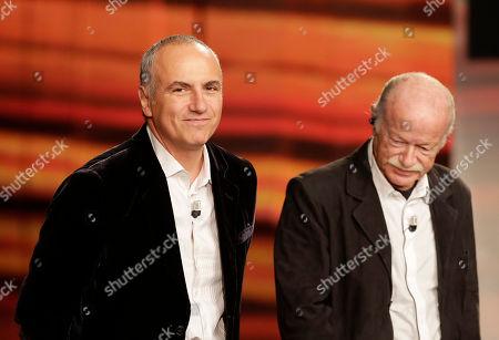 """Italian jazz pianist Danilo Rea, left, smiles with italian singer Gino Paoli during the Italian State RAI TV program """"Che Tempo che Fa"""", in Milan, Italy"""