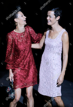 Former models Marpessa Hennink, left, and Nadege pose with prior to the start of the Dolce & Gabbana women's Spring-Summer 2013 fashion collection, during the fashion week in Milan, Italy