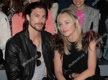 American actress Sharon Stone, right, poses with her boyfriend Martin Mica, of Argentina, prior to the start of the Fendi women's Spring-Summer 2013 fashion collection, during the fashion week in Milan, Italy