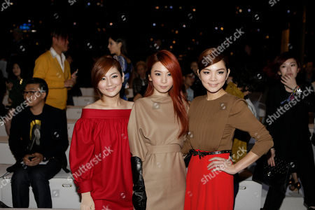 From left, Ella Chen, Hebe Tien and Selina Jen of the Taiwanese music group S.H.E., pose prior to the start of the the Gucci women's Spring-Summer 2013 collection that was presented in Milan, Italy, Wednesday, Sept.19, 2012
